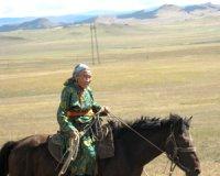 Front veteran Vera Bailak receives a certificate as No.1 sheep herder- thousander