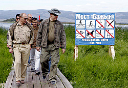 Putin and Prince Albert walking to their Lake Tere-Khol campsite Monday. Photo courtesy AP